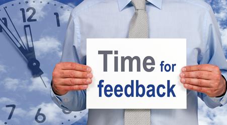sign promoting customer feedback system